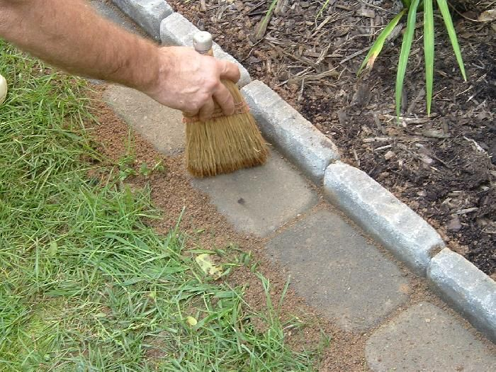 Edging a Flower Bed With Cement Pavers - less weedeating = a good thang