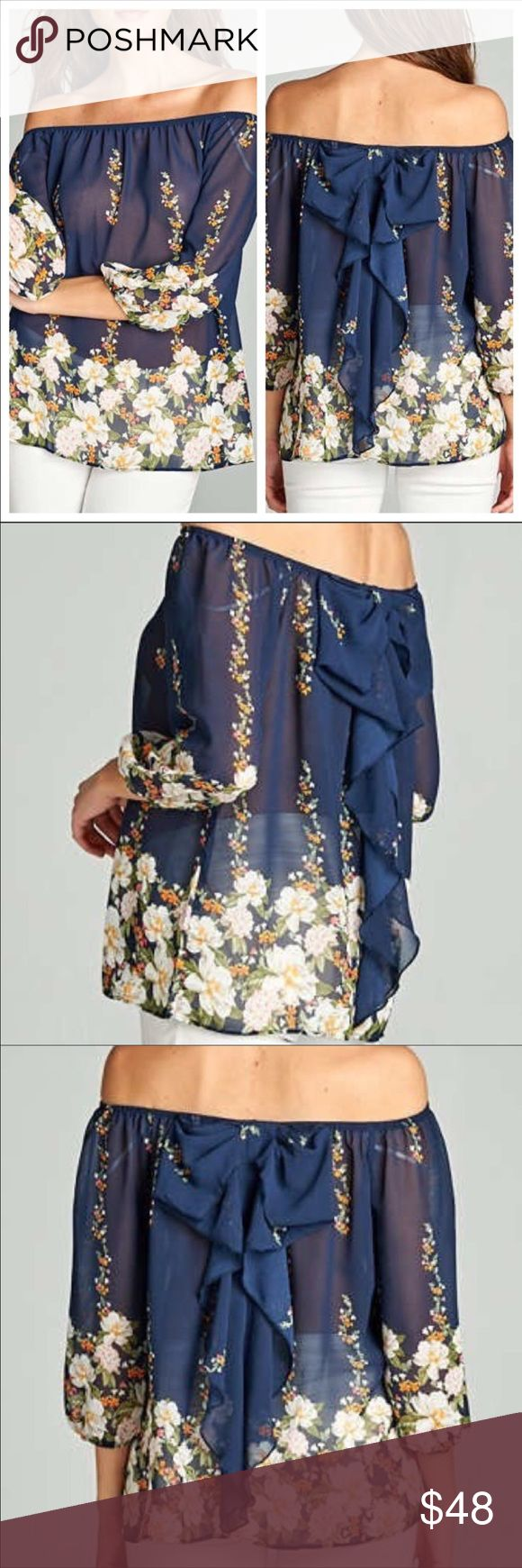 Stunning bow back top navy with florals NWT Stunning bow back top navy with florals NWT. Brand new for the summer 2017 fashion!  #fashionweek all purchases included one free week luxury fashion designer rental from Lavish Lend as well. Tops Blouses
