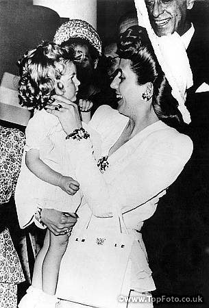 Senora Eva Peron makes friends with a little French girl on her arrival at the Ritz Hotel in Paris. 11th August 1947