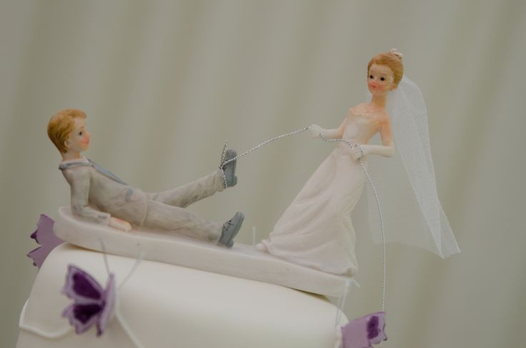 Fab comical wedding cake topper, the bride is the boss!!! ;)