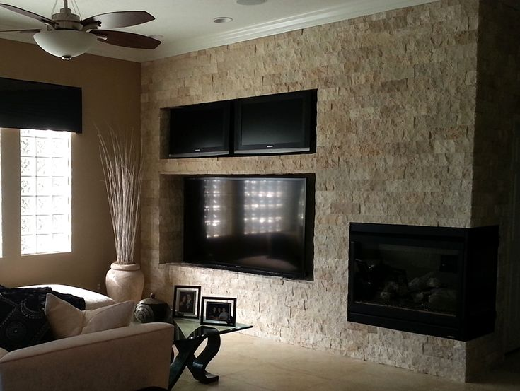 Tiletuesday highlights an installation of our limestone Decorative wall tiles for living room
