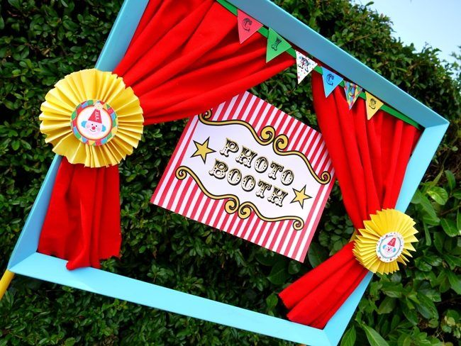 Carnival Photo Booth - convert a large wooden frame into a photo booth that can be adorned with mini curtains, rosettes, bunting and a photo booth sign. Get the DIY here.
