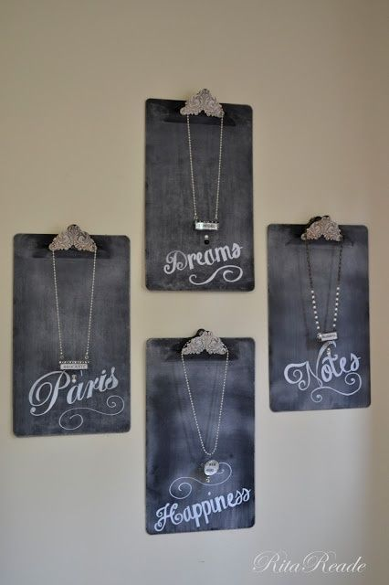 Clipboards painted with chalkboard paint for jewelry display in a craft fair booth