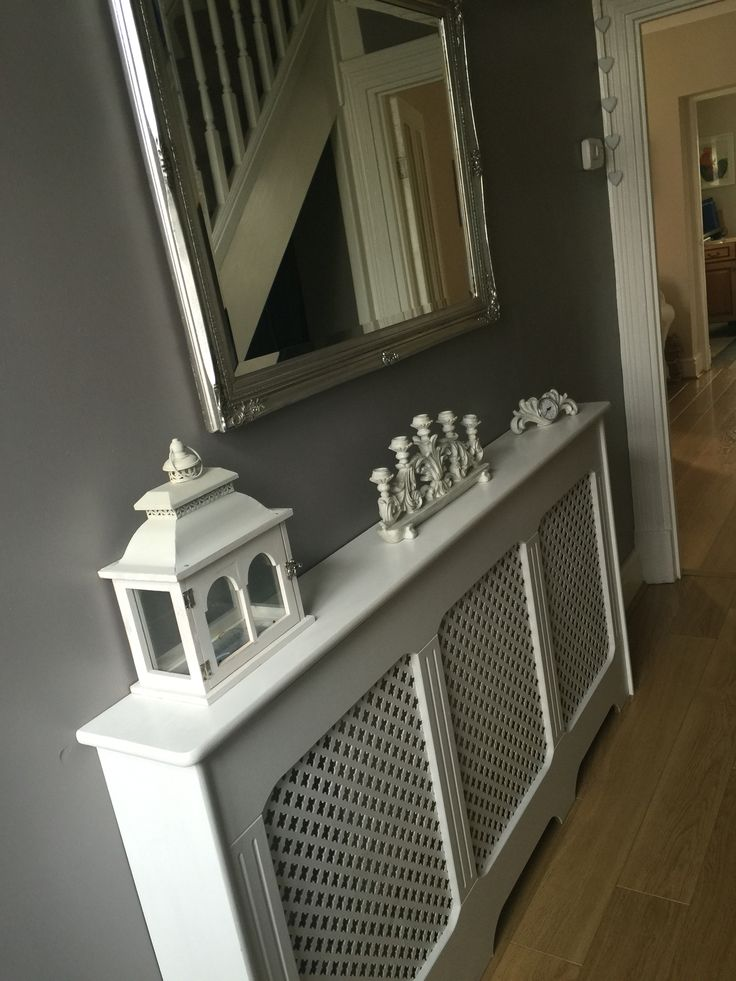 White radiator cover. Grey walls. Love the contrast and how bright grey walls make the white look