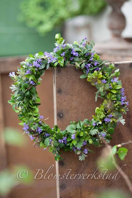 Use what you have - wreath out of weeds and boxwood.