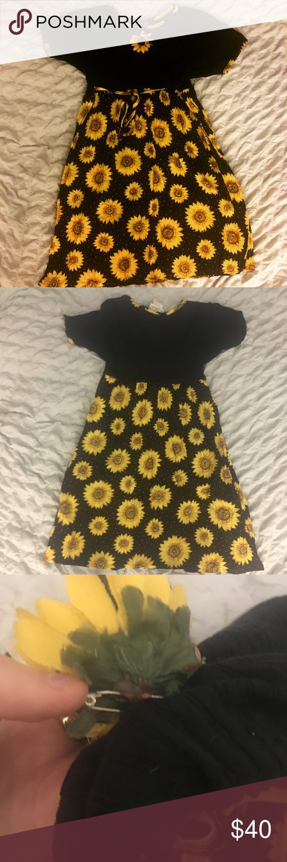 90s sunflower dress Channel your inner 90s goddess with this one-of-a-kind  sunflower baby doll dress. It even has a detachable flower! The tag reads size 18, but it's more of a xs/s size vintage Dresses