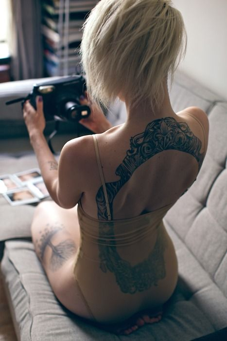 Vintage frame back tattoo.