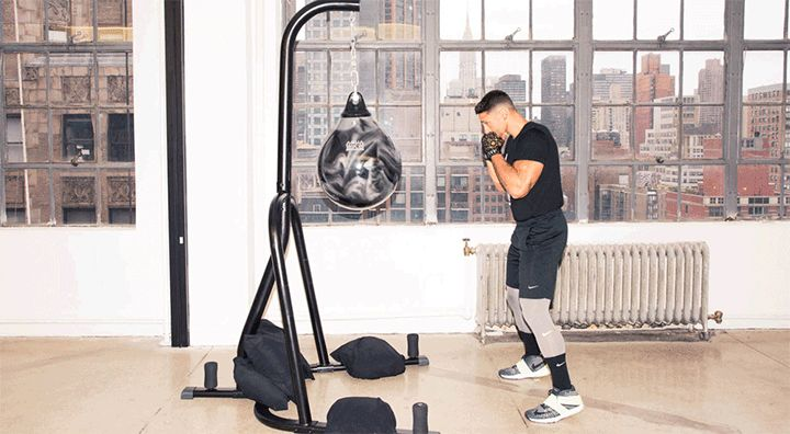 Rumble's Co-Founder Shares a Boxing Workout for Your Butt: Boxing is more than punching and ducking (and imagining your ex's face on a bag). It can also be one hell of a lower-body workout. Don't believe us? Just try the 10 butt-lifting combos that Noah Neiman, the trainer and co-founder of Rumble (NYC's newest, you guessed it, boxing studio), created just for us.How to punch out with high knees. | coveteur.com