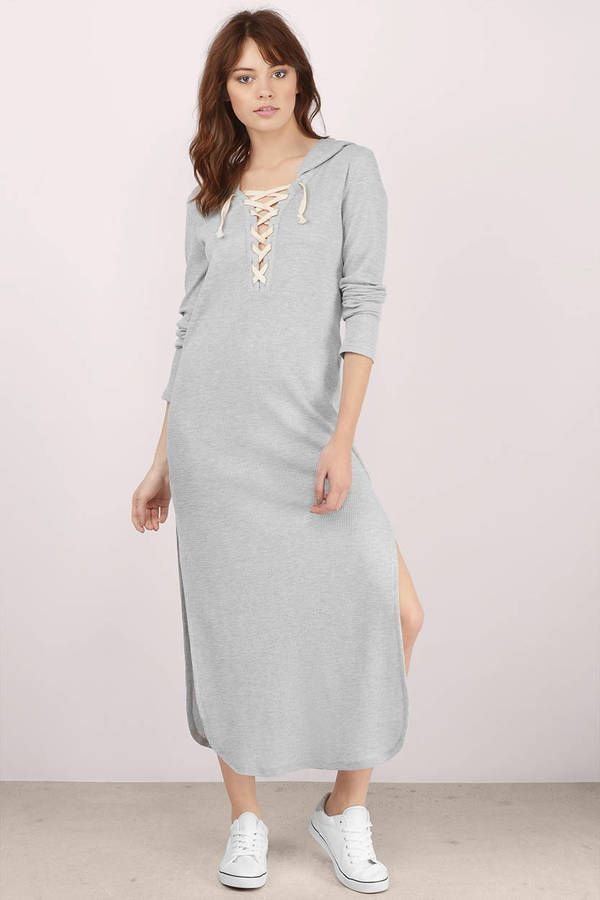 The Aziela Hooded Maxi Dress takes casual style to a new level of chic. This sweatshirt maxi dress features a shirt tail hem with side slits, a hood a #shoptobi