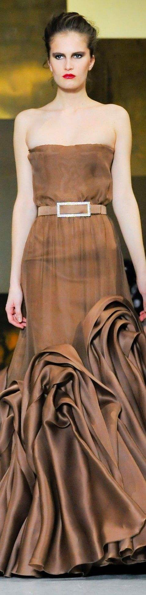 Stephane Rolland - I would love this gown in a different color - I'm thinking a soft pink so the billowy folds would look like cotton candy!  I would also like the top to have a higher bodice - just me - I am a little fuller than this very thin model - so on me this would be much too revealing!