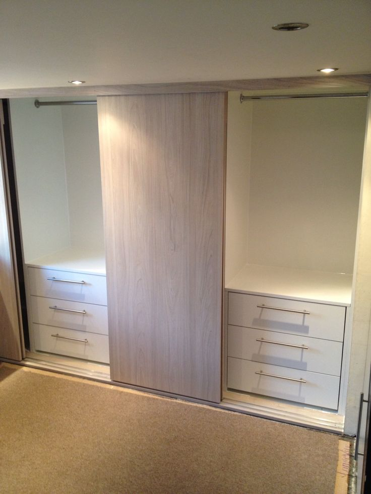The wardrobes have two 3 draw units and two long hanging with shoe shelves