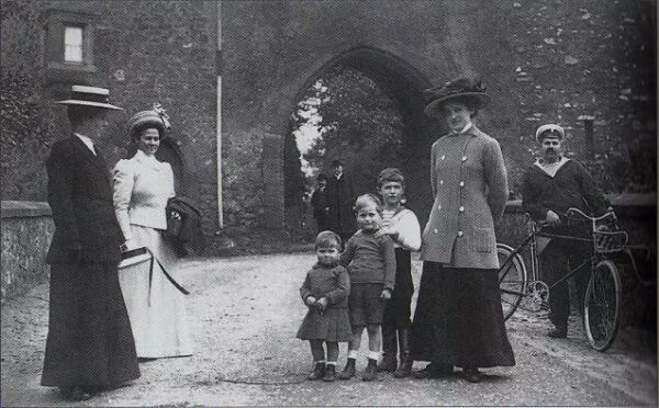 """Tsarevich Alexei Nikolaevich Romanov of Russia with his two cousins,Hereditary Prince Georg Donatus and Prince Ludwig of Hesse (Darmstadt) and By Rhine.Alexei's sailor-nanny is at the right of the photo,Andrei Eremeyevich Derevenko.Alexei's nanny Mariya Ivanovna Vishnyakova is at the left of the photo. """"AL"""""""