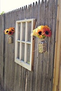Old window backyard fence decoration. Simple and adorable. This would be cute on the fence!