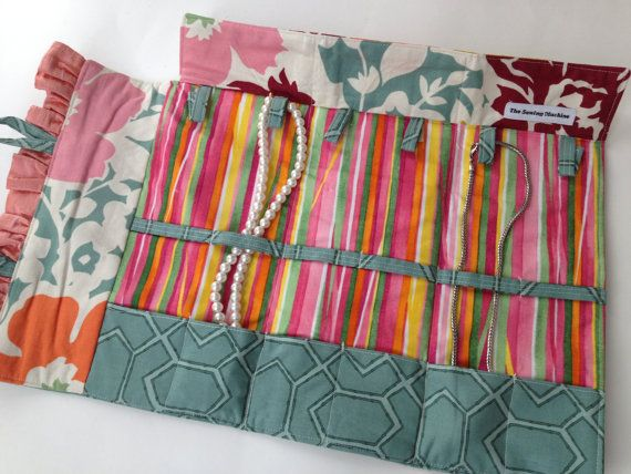 Necklace Travel Case in green gray, orange and pink cotton fabric, fold up jewelry organizer, roll up travel jewelry case. $46.00, via Etsy.