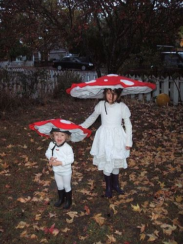 Last minute costumes for the girls.  Super easy to make.  Bike helmets with circles of cardboard, covered with batting and fleece. All held together with wire and spray-tack.
