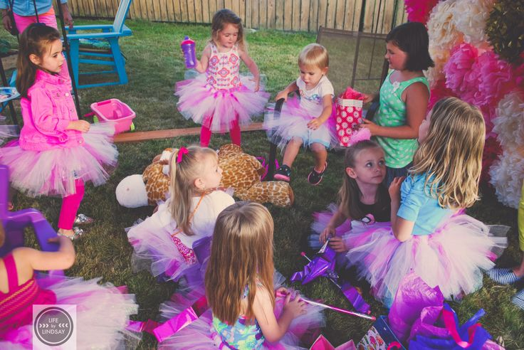 tutu party favors, and tissue flower photo wall