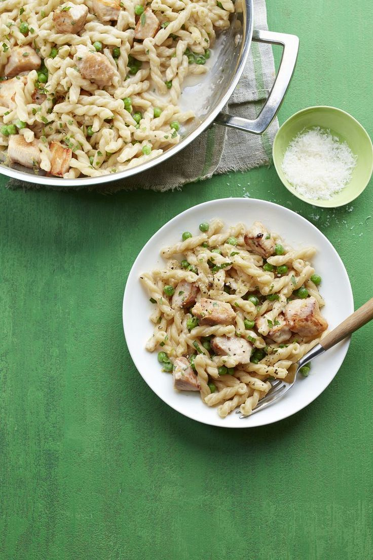 "Lemon Chicken and Pea Gemelli Recipe    2 tbsp. extra-virgin olive oil  12 oz. boneless, skinless chicken breasts, cut into 2"" pieces  kosher salt  Freshly ground black pepper  1/4 c. fresh lemon juice  4 c. low-sodium chicken broth  12 oz. gemelli or other short pasta  4 oz. cream cheese, at room temperature  1 c. peas, thawed if frozen  2 tsp. lemon zest  1/2 c. finely grated Parmesan  1 tbsp. finely chopped tarragon"