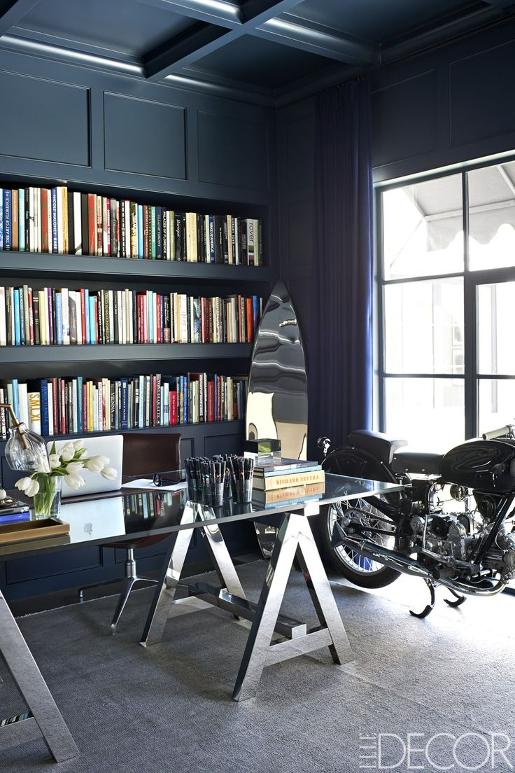 Giannulli's office holds a desk by Ralph Lauren Home, a Marc Newson surfboard sculpture, and a 1952 Moto Guzzi motorcycle; the curtains are of a wool by Loro Piana, the rug is by Beauvais, and the walls and ceiling are lacquered in Benjamin Moore's Polo Blue.   - ELLEDecor.com