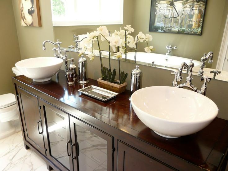 WhenHGTV fan rachelcar decided to renovate, she wanted to create an urban, chic bathroom. She opted for vessel sinks and retrofitted dressers rather than typical cabinetry.