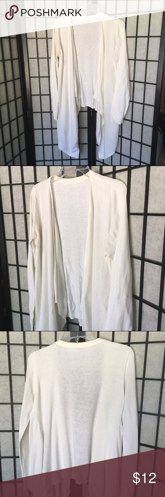 """No Tags plus size Cover up sweater No tags cream or off white cover up sweater long in front and short on back Fits Size X Large to XXL In pre Owned good condition :FB  Approx. Laying flat: Armpit to Armpit: 24.5"""" Shoulder to Bottom Hem: 28""""  Feel free to ask any questions. Sorry No trades, no modeling. Check out the other items in my closet. Bundles are 20% off 3 + items.  I consider all offers!   Happy POSHING!! No Tags Sweaters Shrugs & Ponchos"""