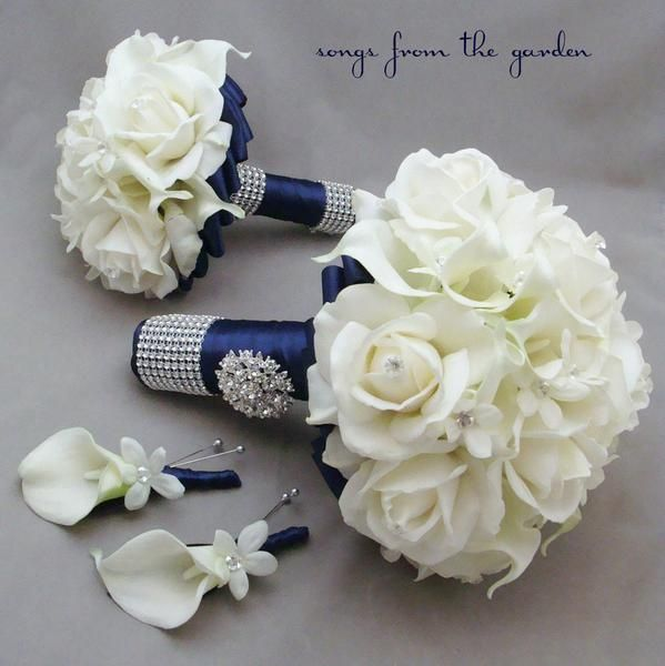 """This wedding flower package can be part of your destination wedding day! I can create them for you as shown or customize it to fit your color scheme. We can work together to create a custom silk flower wedding package for your entire wedding party! This 4-piece wedding flower package includes a silk flower bridal bouquet that is 9"""" in diameter and includes white real touch roses, white real touch calla lilies and white silk stephanotis blooms adorned with diamante pins. The real touch roses…"""