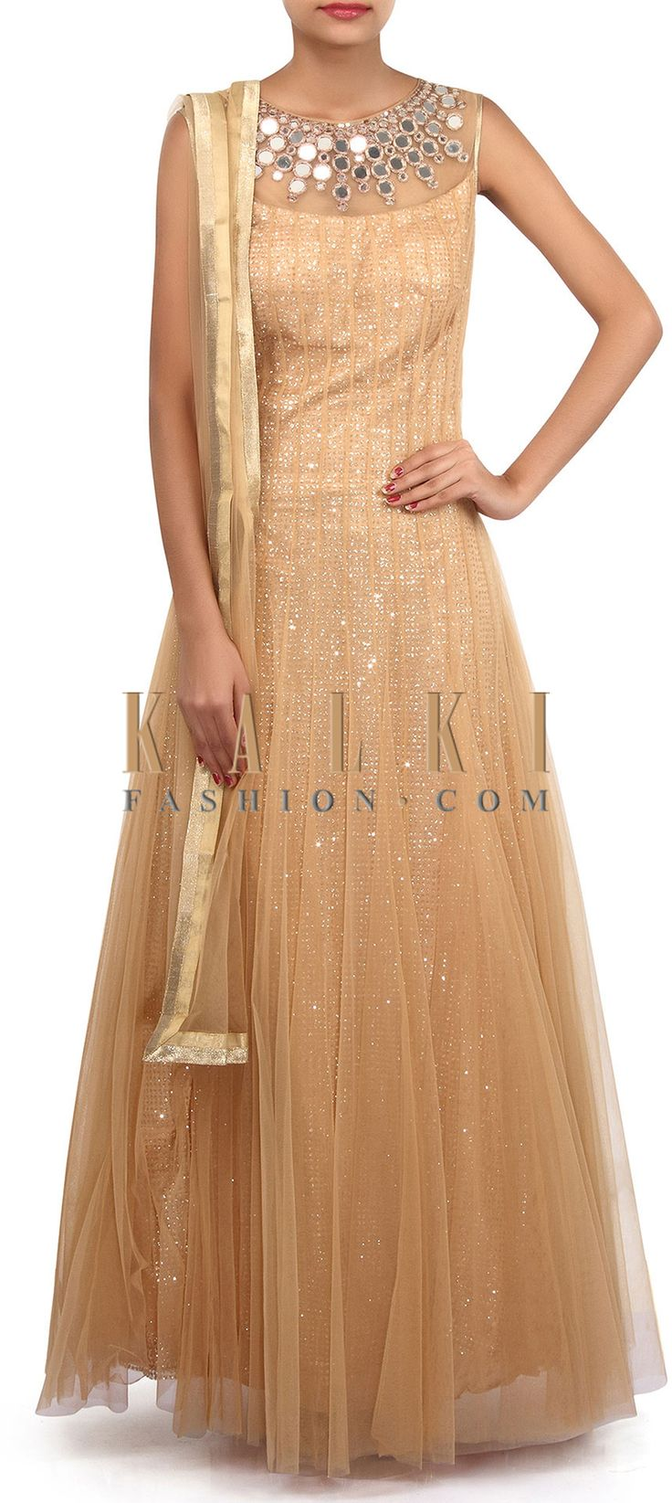 Buy Online from the link below. We ship worldwide (Free Shipping over US$100). Product SKU - 305723.Product Link - http://www.kalkifashion.com/gold-anarkali-suit-adorn-in-sequin-and-mirror-embroidery-only-on-kalki.html