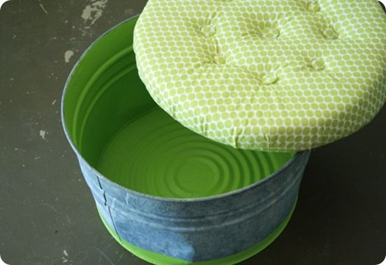 I adore this idea :) Turning a galvanized bucket into a cool storage ottoman.