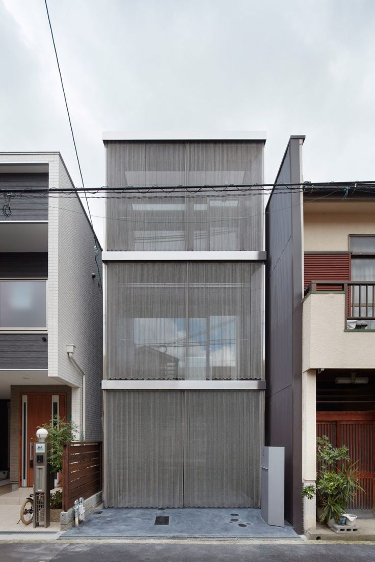 Steel chain curtains cover skinny osaka house by fujiwaramuro architects beautiful buildingsbeautiful architectureurban settingjapan