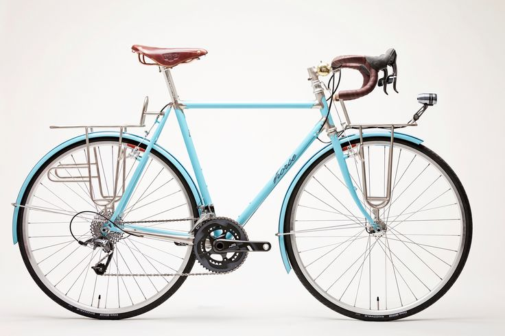 CyclingAbout – The 18 Nicest Touring Bikes in the World - Horse Cycles - Light blue is pretty much my favourite colour, so it is no suprise that this stainless steel Horse by Thomas Callahan in New York (USA) makes the list. It seems a bit more randonneur than most on this list, but given it has custom front and rear racks we'll consider it a tourer. The colour-matched 'guards look incredible, as do the racks and fillet-brazed stem. My only gripe is that the crankset does not fit in… at all.