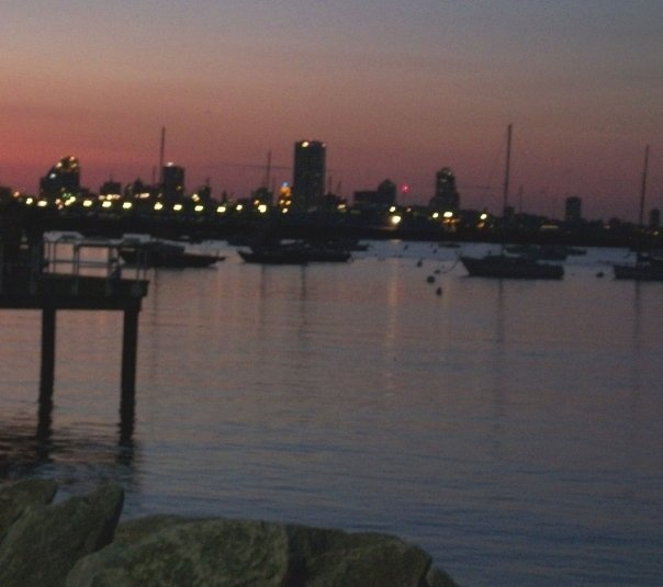 Milwaukee skyline and South Shore marina, viewed from South Shore Park at sunset. Milwaukee