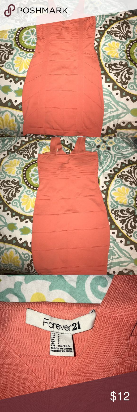 Bodycon style peach dress Tight Peach color dress size small. Worn once to an event. Really pretty color Forever 21 Dresses Mini