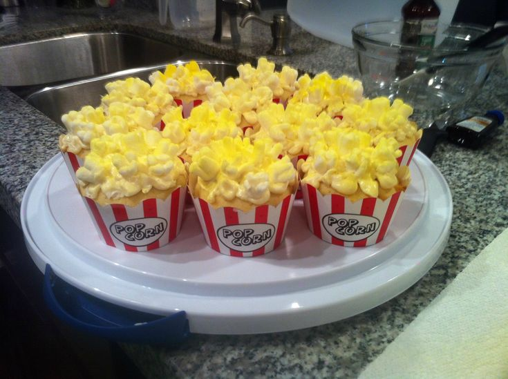 "They're cupcakes!  The ""popcorn"" is a layer of butter cream and then marshmallows cut into an ""X"" on top.  Must have a party now!"