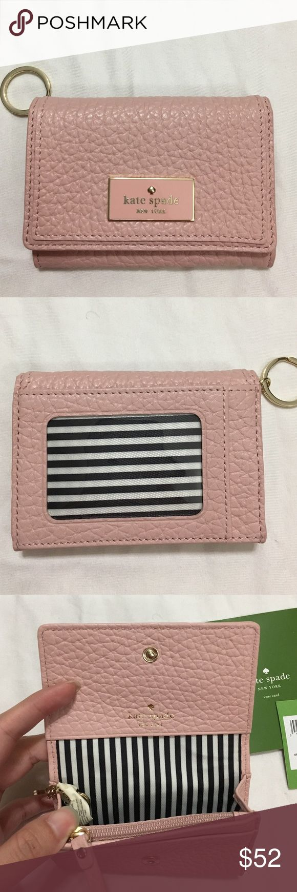 SALE Kate spade mini wallet keychain Kate spade mini wallet keychain in light pink. Super cute and compact. Coin pocket, I.D. Slot, metal emblem. New with tags kate spade Bags Wallets