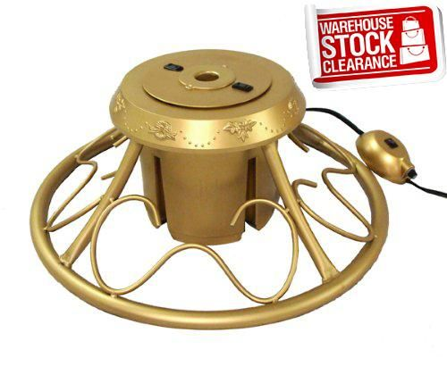 #limited Rotating tree stand for artificial Christmas trees. Item #23893. Features: Tree stand is done in gold #with decorative scroll work for a very elegant lo...