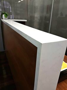 3m long reception desk with stone counter top for law firm Speirs Ryan in Sydney CBD