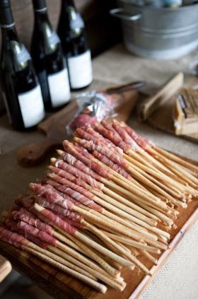Prosciutto wrapped Italian breadsticks. Simple addition for a cocktail party spread.