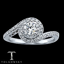Tolkowsky ring...with a bigger sapphire in the center. The unusual setting is so pretty and makes my finger look dainty!Style, Engagement Ring
