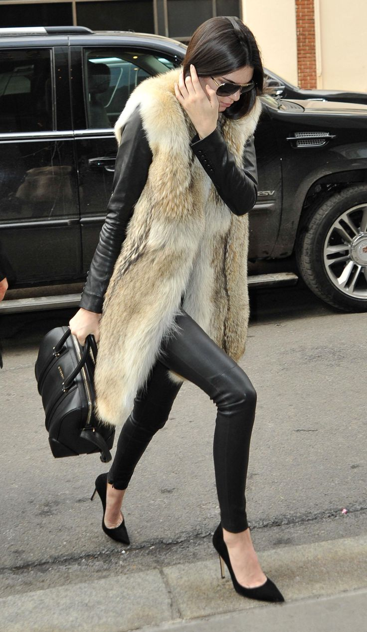 Kendall Jenner Street Style: See Her 20 Best Looks - skin tight leather leggings paired with a longline fur vest and classic pointy toe heels
