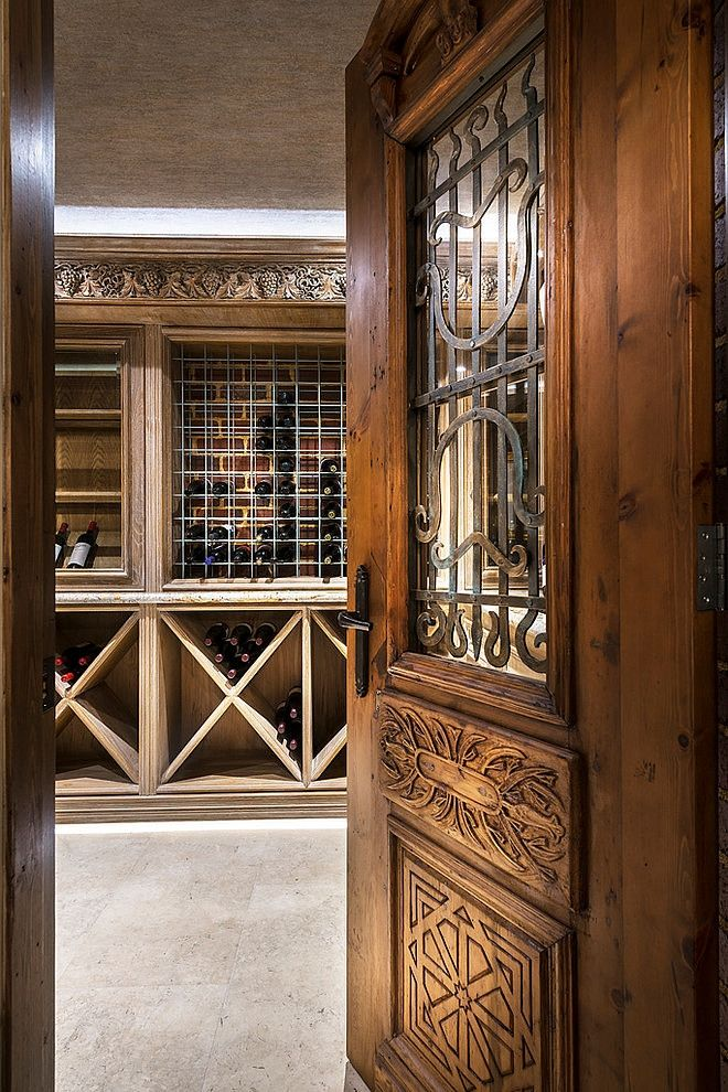 Dalkeith Residence by Oswald Homes. Wine cellar with beautiful door and great millwork.