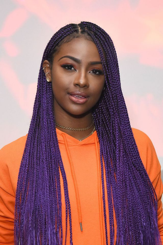 """Purple Unicorn"" Justine Skye performed at a Forever 21 event in Glendale, Calif., wearing bright purple box braids, perfectly arched brows and nude lip gloss. (Photo by Araya Diaz/Getty Images)"