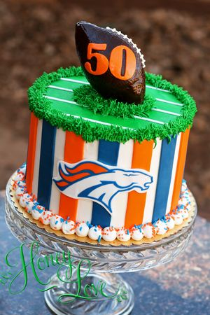 Denver Broncos football cake. Follow HoneyLove Cakery on twitter and instagram. www.HoneyLoveCakery.com