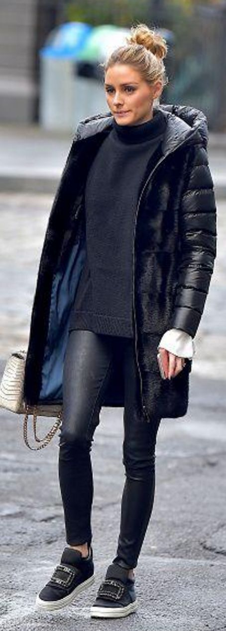 Who made  Olivia Palermo's crystal sneakers, black leather pants, tan handbag, and down coat?