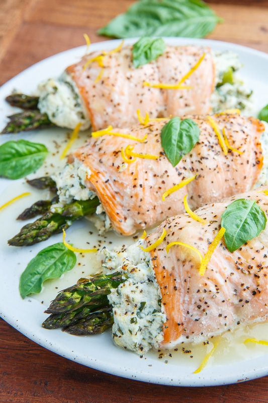 Salmon rolls stuffed with a summery lemon and basil ricotta and asparagus that is baked and served with a fresh and tasty lemon sauce!