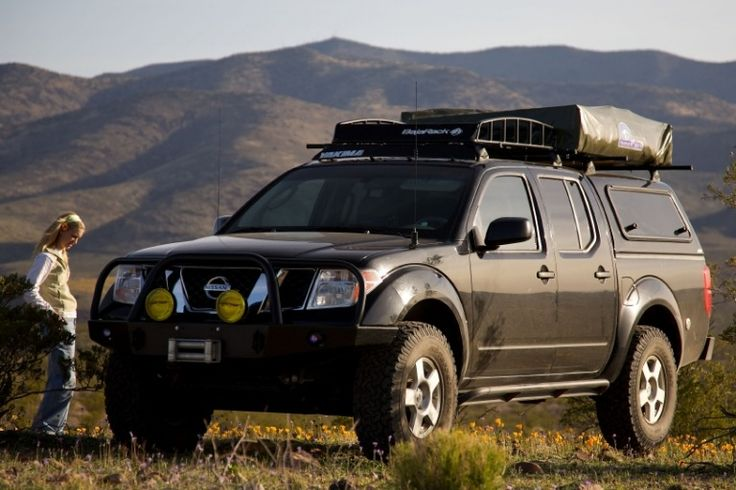 Nissan Frontier with ARE Series V Camper Shell with the swing up side window option.