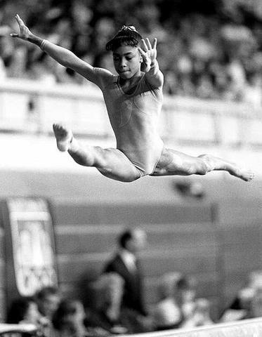 Dominique Dawes -- (11/20/1976-??). Artistic Gymnast [RETIRED].