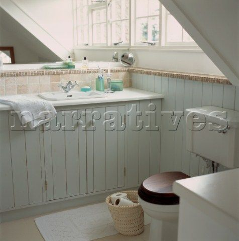 neutral painted and wood paneled small attic bathroom with eaves - Painted Wood Bathroom Interior