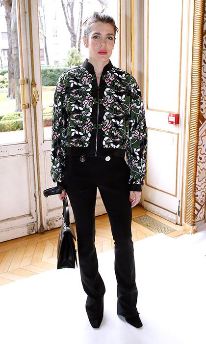 Charlotte doesn't often wear pants but when she does she keeps it simple and chic. A floral bomber adds the perfect flair to black trousers at Giambattista Valli's Paris Fashion Week Fall/Winter 2017/2018 presentation.  Photo: Bertrand Rindoff Petroff/Getty Images