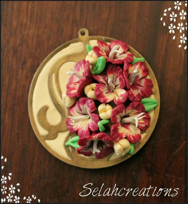 Polymer clay pendant with mini flowrrs in cream & maroon.