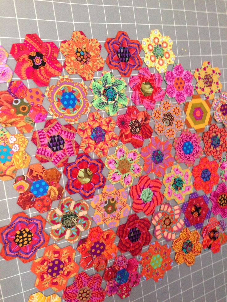 Luscious colors from Kaffe done up in fussy-cut hexagons!