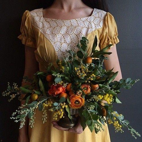 Rich autumn hues abound in this lovely orange arrangement